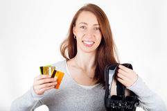 Beautiful woman holding new delivered shoes in one hand and cred. It cards in other hand. Online shopping concept Royalty Free Stock Images