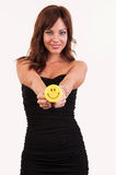 Beautiful woman holding object with happy smiley Royalty Free Stock Photo
