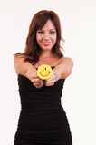 Beautiful woman holding object with happy smiley Royalty Free Stock Image