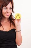 Beautiful woman holding object with happy smiley Stock Photo
