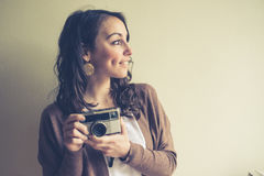 Beautiful woman holding old camera Royalty Free Stock Photos