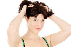 A beautiful woman is holding onto their hair Stock Image