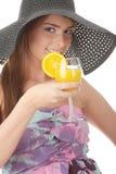 Beautiful woman holding a orange cocktail Stock Photo