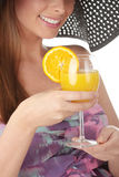Beautiful woman holding a orange cocktail Royalty Free Stock Photo