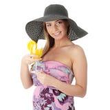 Beautiful woman holding a orange cocktail Stock Photos