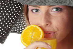 Beautiful woman holding a orange cocktail Stock Images