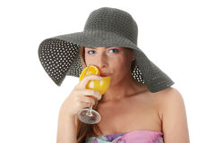 Beautiful woman holding a orange cocktail Royalty Free Stock Photos