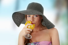 Beautiful woman holding a orange cocktail Royalty Free Stock Photography