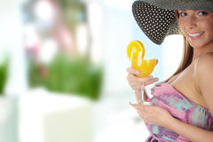 Beautiful woman holding a orange cocktail Stock Photography