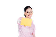 Beautiful woman holding out a blank card Stock Photo