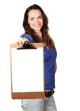 Beautiful woman holding out blank clipboard Royalty Free Stock Image