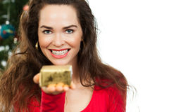 Beautiful woman holding out Christmas gift Stock Image