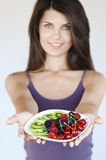 Beautiful Woman Holding Out Plate Of Fruit Stock Images