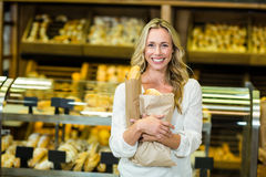 Beautiful woman holding paper bag with bread Royalty Free Stock Photos