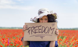 Beautiful woman holding a paper banner with text Stock Photos