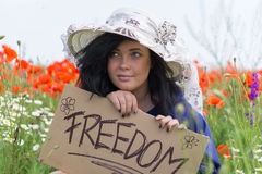Beautiful woman holding a paper banner with text Royalty Free Stock Photography
