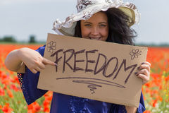 Beautiful woman holding a paper banner with text Royalty Free Stock Photo
