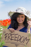 Beautiful woman holding a paper banner with text Royalty Free Stock Photos
