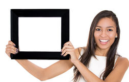 beautiful woman holding a picture frame Royalty Free Stock Images