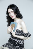 Beautiful woman holding an picture frame. Studio portrait Royalty Free Stock Photography