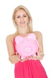 Beautiful woman holding a piggybank. Isolated on white Royalty Free Stock Photos