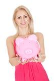 Beautiful woman holding a piggybank Royalty Free Stock Photos