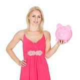 Beautiful woman holding a piggybank. Isolated on white Royalty Free Stock Photography