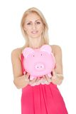 Beautiful woman holding a piggybank. Isolated on white Stock Photography