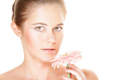 Beautiful woman holding pink flower Stock Images