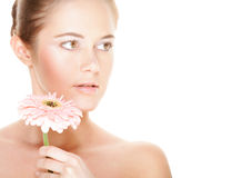 Beautiful woman holding pink flower Royalty Free Stock Photography