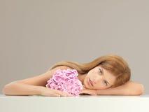 Beautiful woman holding a pink hydrangea Royalty Free Stock Photo