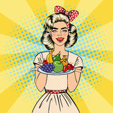Beautiful Woman Holding a Plate with Fruits. Housewife with Fruits. Pop Art. Vector Stock Images