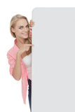 Beautiful woman holding and pointing at blank white board Stock Photos