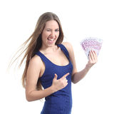 Beautiful woman holding and pointing a lot of five hundred euro banknotes. Isolated on a white background Stock Photo