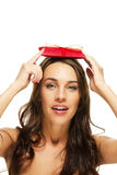 Beautiful woman holding present on her head Stock Photography