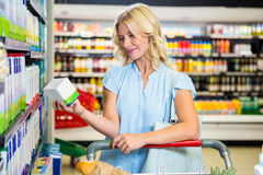 Beautiful woman holding product Royalty Free Stock Photos