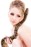 Beautiful woman holding Python on isolated white Stock Photography