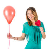 Beautiful woman holding red balloon and heart-shaped lollypop Royalty Free Stock Image