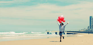 Beautiful woman holding red balloons Royalty Free Stock Image