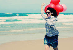 Beautiful woman holding red balloons Stock Photo