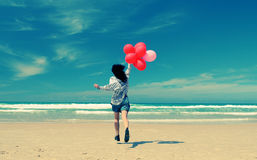 Beautiful woman holding red balloons Royalty Free Stock Images