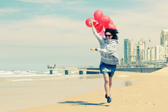 Beautiful woman holding red balloons Stock Photos