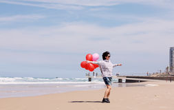 Beautiful woman holding red balloons Royalty Free Stock Photos