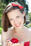 Beautiful woman holding red flower Stock Image