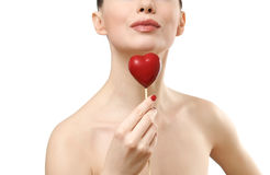 Beautiful woman holding red heart. Stock Photo
