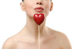 Beautiful woman holding red heart. Royalty Free Stock Photography