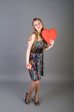 Beautiful woman holding red heart Stock Photos