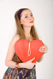 Beautiful woman holding red heart Stock Image