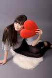 Beautiful woman holding red heart Stock Photography