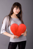 Beautiful woman holding red heart Stock Photo